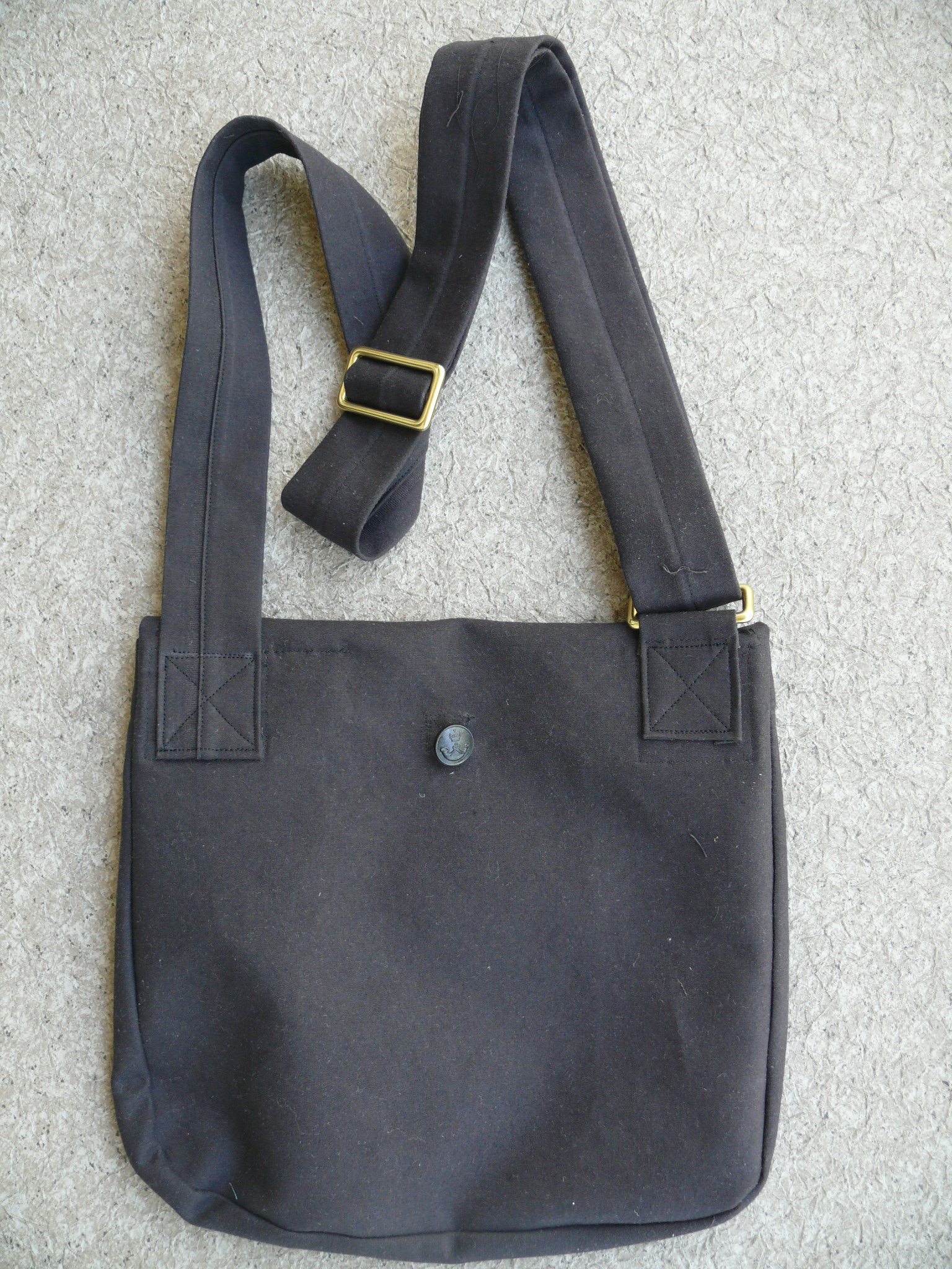 Back view.......The button on this side is used when the bag is empty and rolled up to conserve space.
