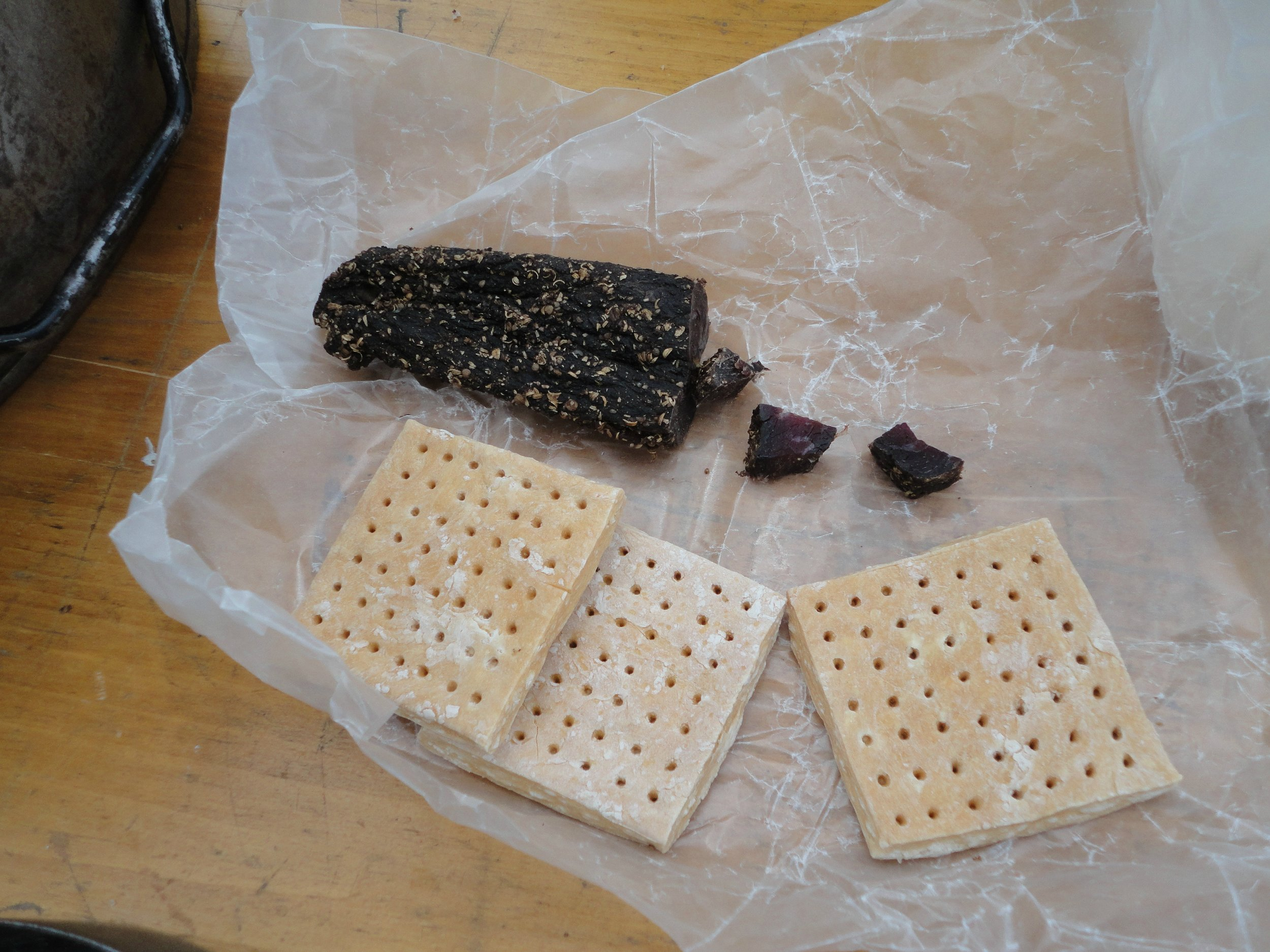 The pictured Hardtack reproduces original examples from the Boer War that had exactly 49 holes (count them...).  Also pictured is an example of Biltong sausage which tastes way better than it looks...