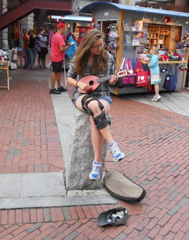 Busking at Quincey Market a few months after surgery. That brace was the worst.