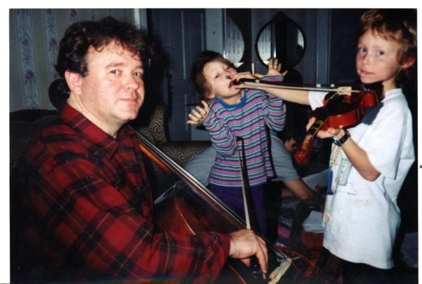 My dad, older brother, and I fooling around with our first webcam and some instruments sometime in the 1990's