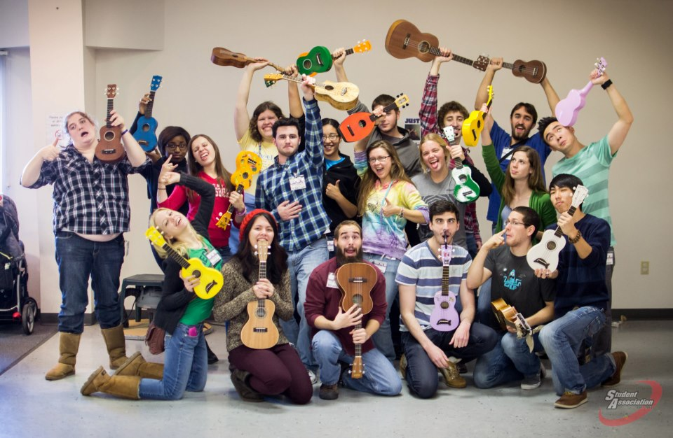 The SUNY Plattsburgh Uke A Dooks volunteering at a children's museum in fall of 2012. That's me in the center with the rainbow sweatshirt and pineapple shaped uke.