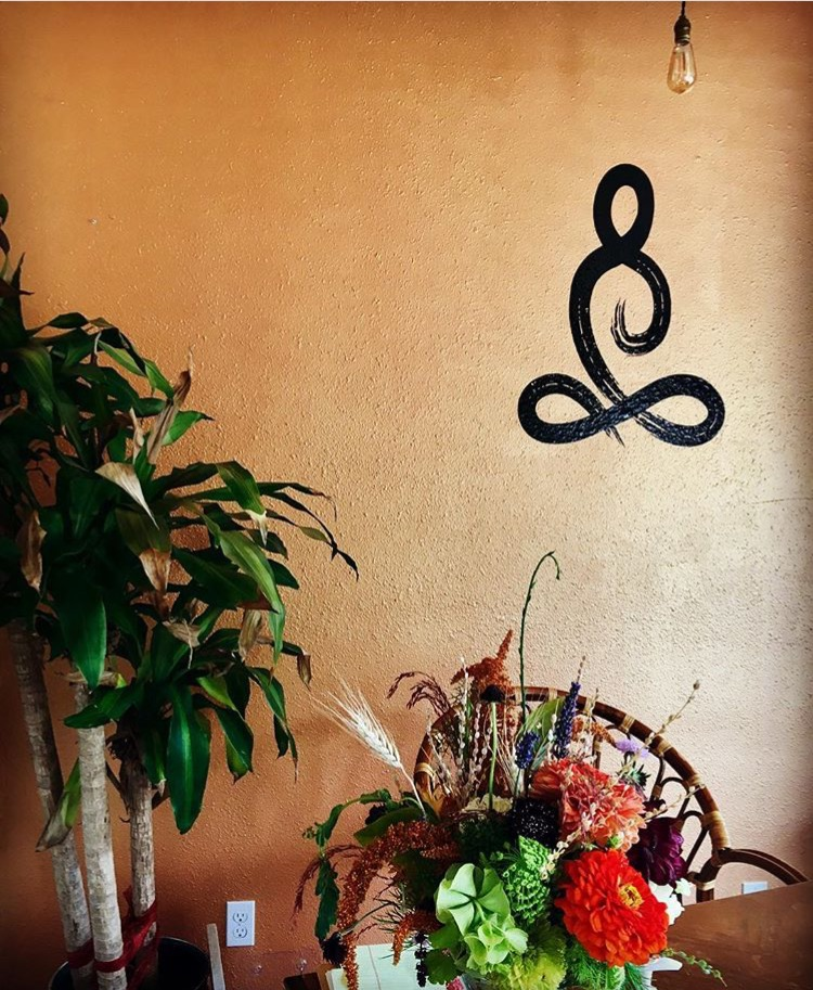 Visitors to Kitsap Hot Yoga are welcomed by a hand-painted lotus pose symbol that transcends time and religion. The pose is said to have the power to settle your nerves, awaken your energy and quiet your mind.