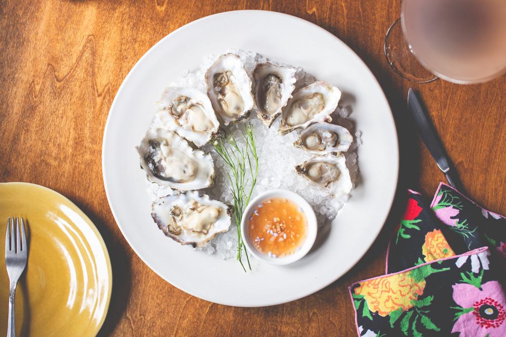"""Brittany's mouthwatering capture of oysters on the half shell illustrate why Peerspace recently named her one of Seattle's """"Top 12 Food Photographers""""."""