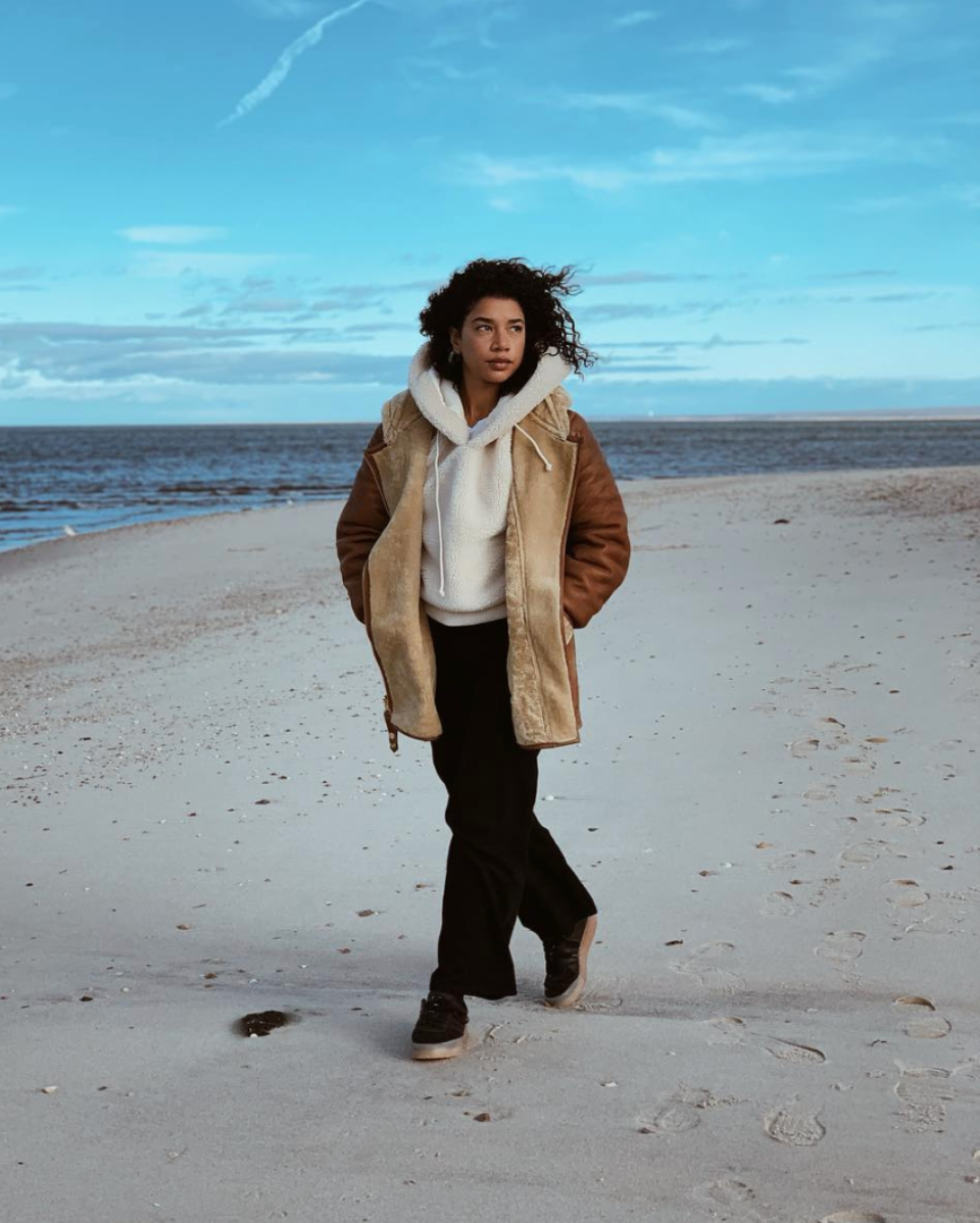 DJ & Entrepreneur Hannah Bronfman ( @hannahbronfman ) wears the SILJA Hooded Shearling in Gingersnap.