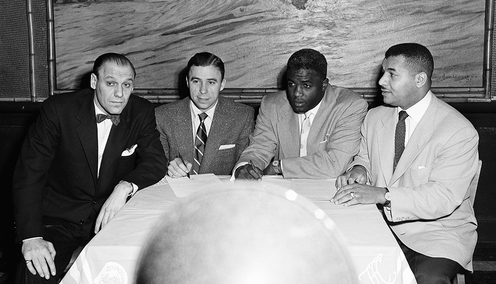 Bavasi with Dodgers stars Pee Wee Reese, Jackie Robinson, and Roy Campanella (L-R) after the signing of their contracts.
