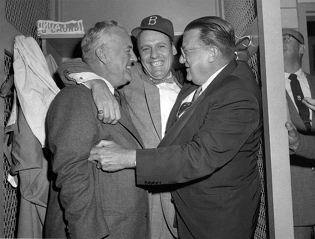 Bavasi celebrating after Game 7 of the World Series with VP Fresco Thompson (L) and Owner Walter O'Malley
