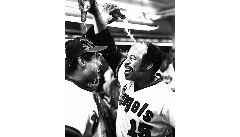 California Angels win American League West Division title  Bavasi signed future Hall of Famer Reggie Jackson to the Angels, shown here with Ron Jackson (R) celebrating the team's second AL West Division title.
