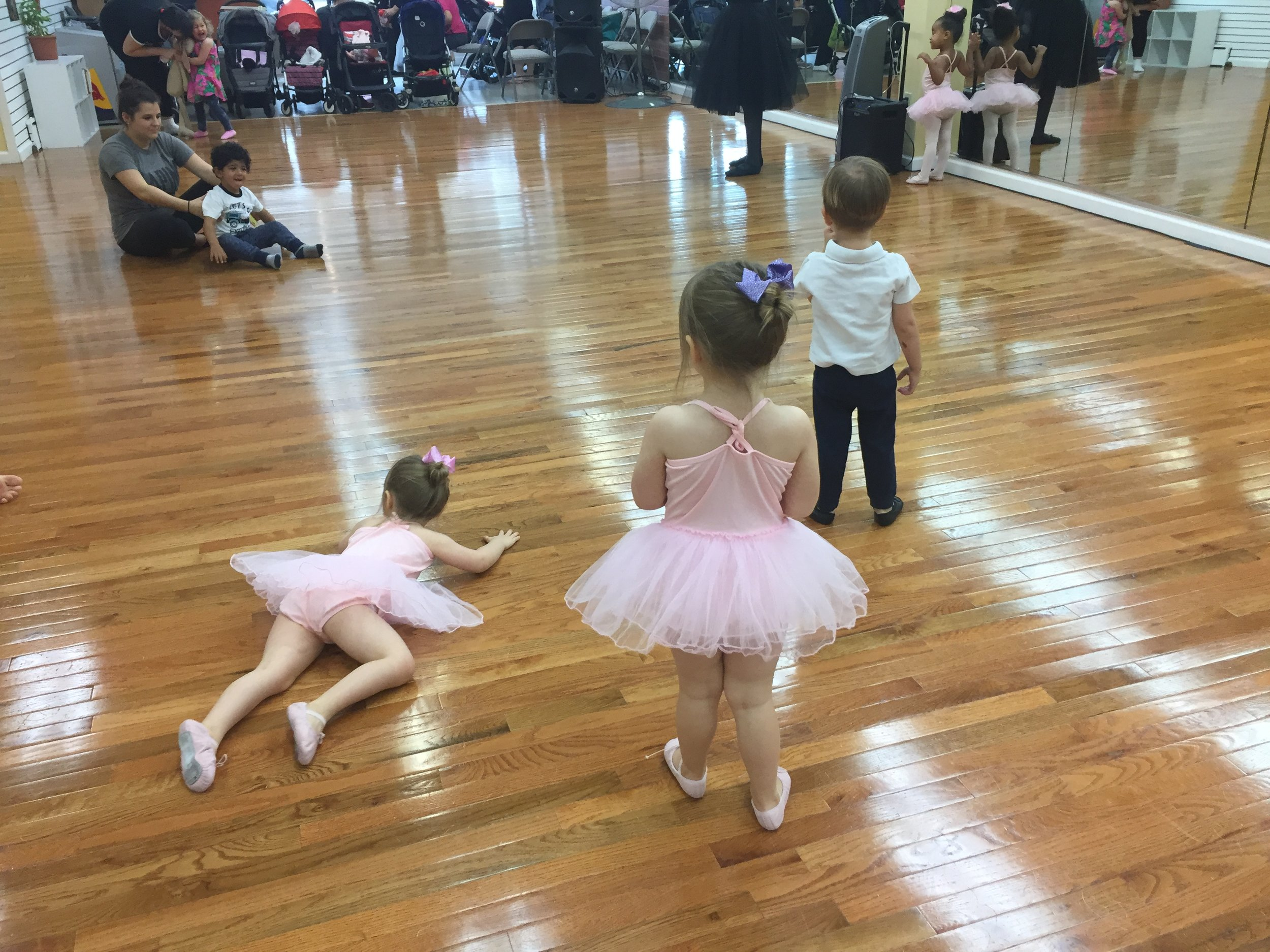 Petite Dancers relax and focus before serious dancing begins! Are you ready to Cha Cha?