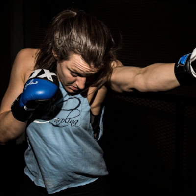 Colleen Daly  is a Fit To Fight certified instructor, Krav Maga Brown Belt, and a 10th Planet Jiu Jitsu Blue Belt. She practices Krav Maga, Muay Thai, Boxing, Kickboxing, and Jiu Jitsu. Colleen has 9 years experience teaching fitness and personal training. Colleen is also the Executive Director of Guerrera: a feminist fight club that incorporates social justice activism into martial athletics. Colleen is a die-hard Tar Heel and can be found picking fights with Duke fans across DC.    1 Hour Session - $100  30 Minute Session - $60