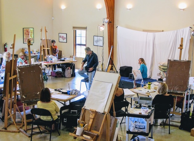 David Limrite giving a demonstration on figure drawing and painting.