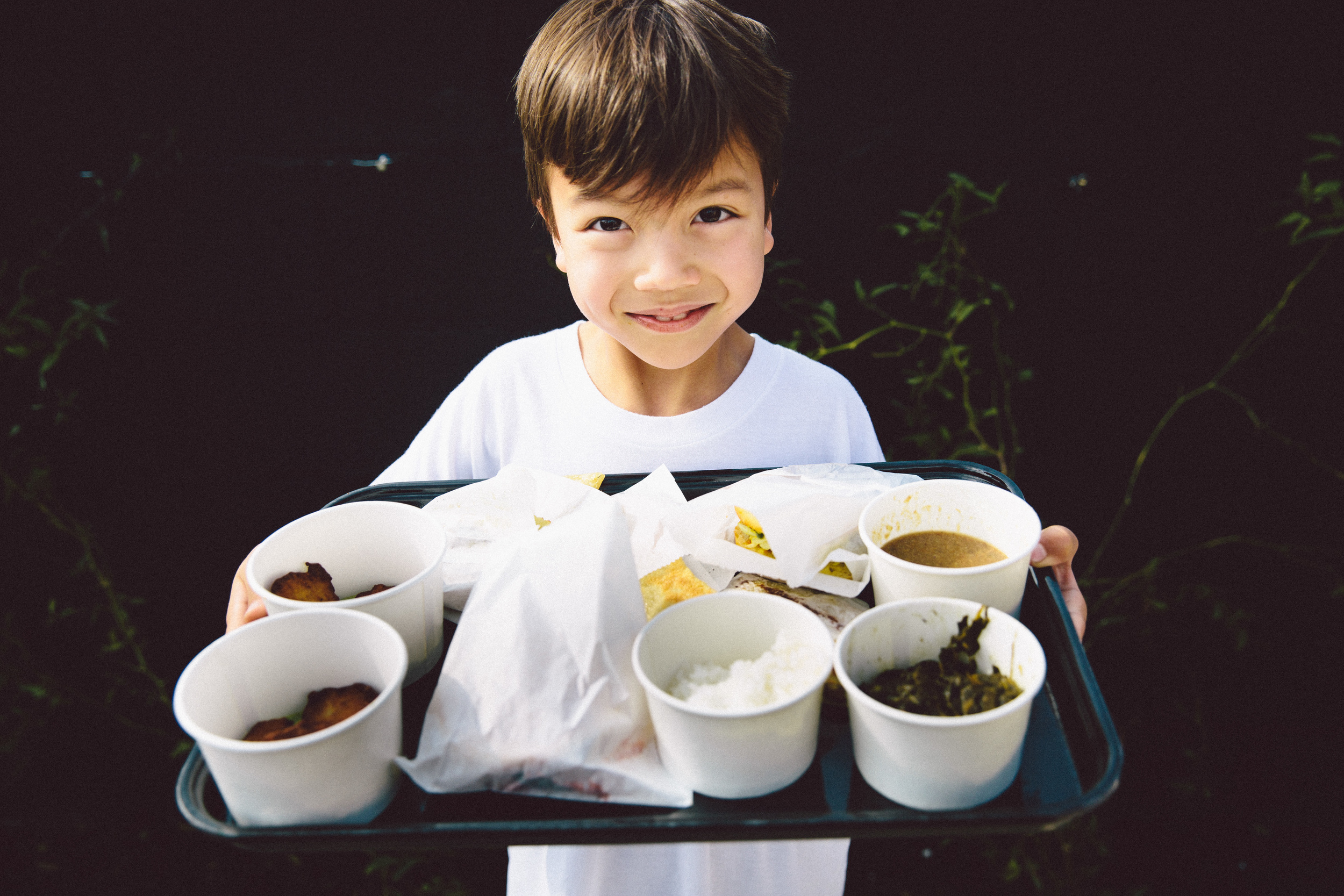 Child showing his tray of LocoL Food ©Audrey Ma
