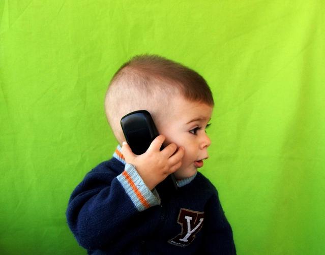 Child on mobile phone www.thehappyhabitat.com.au