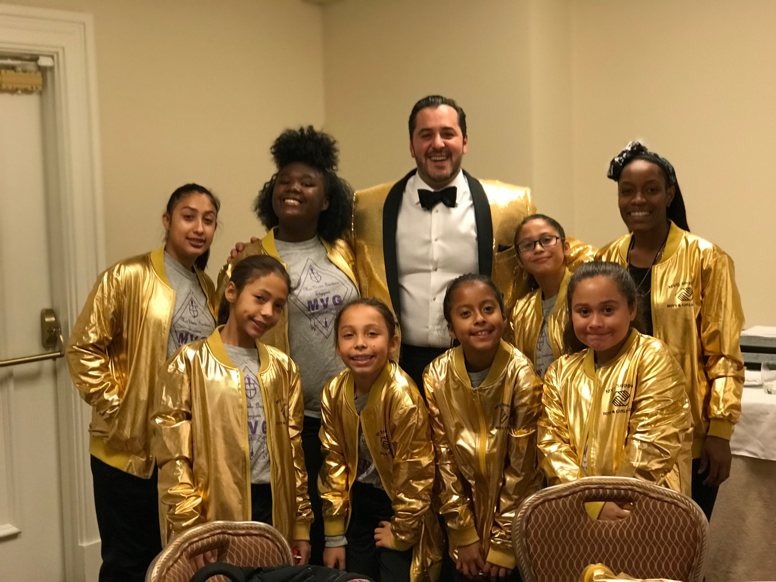 I surprised the MVG Steppers with matchinig gold jackets just before their performance. They loved it !!
