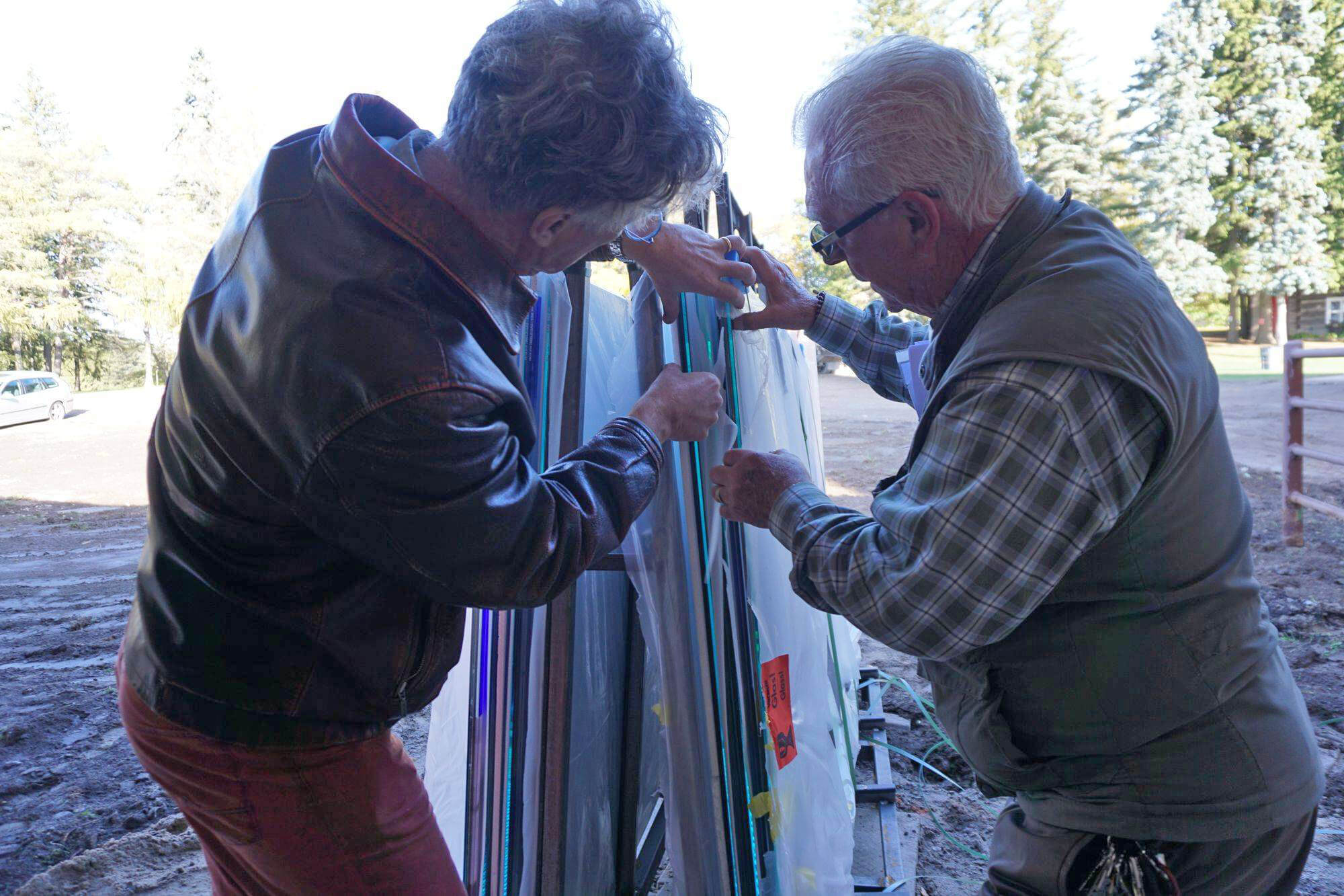 Ted Harasti, The Creative Director and Project Manager, and the Stations Artist, Stuart Reid, inspect the condition of these, one-of-a-kind precious pieces of art.