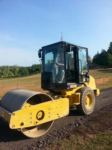 Ted Harasti running the vibrating, compacting roller for three days.