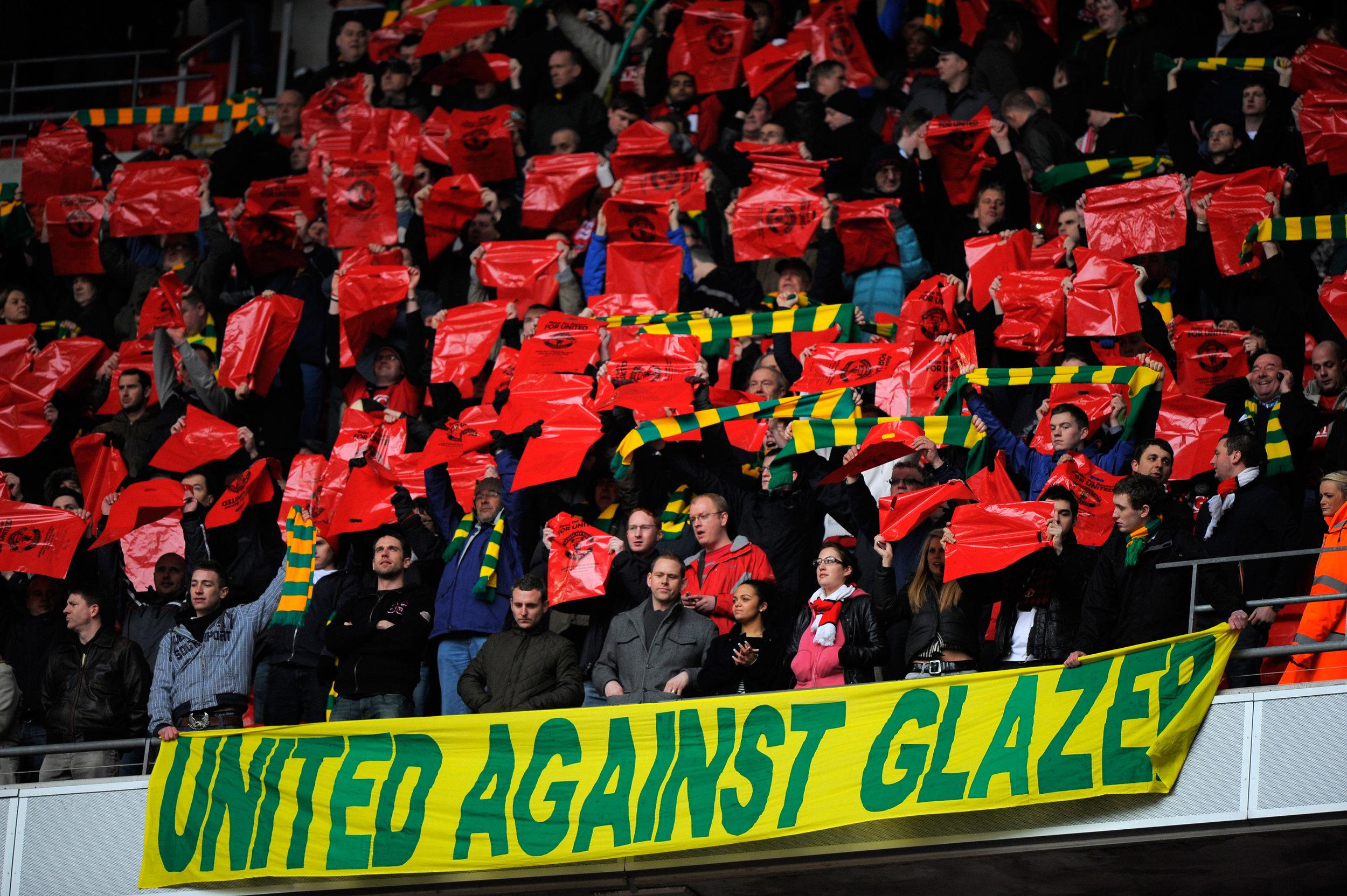 United-tilhængere har flere gange vist deres utilfredshed med Malcolm Glazer.   Foto: Getty Images