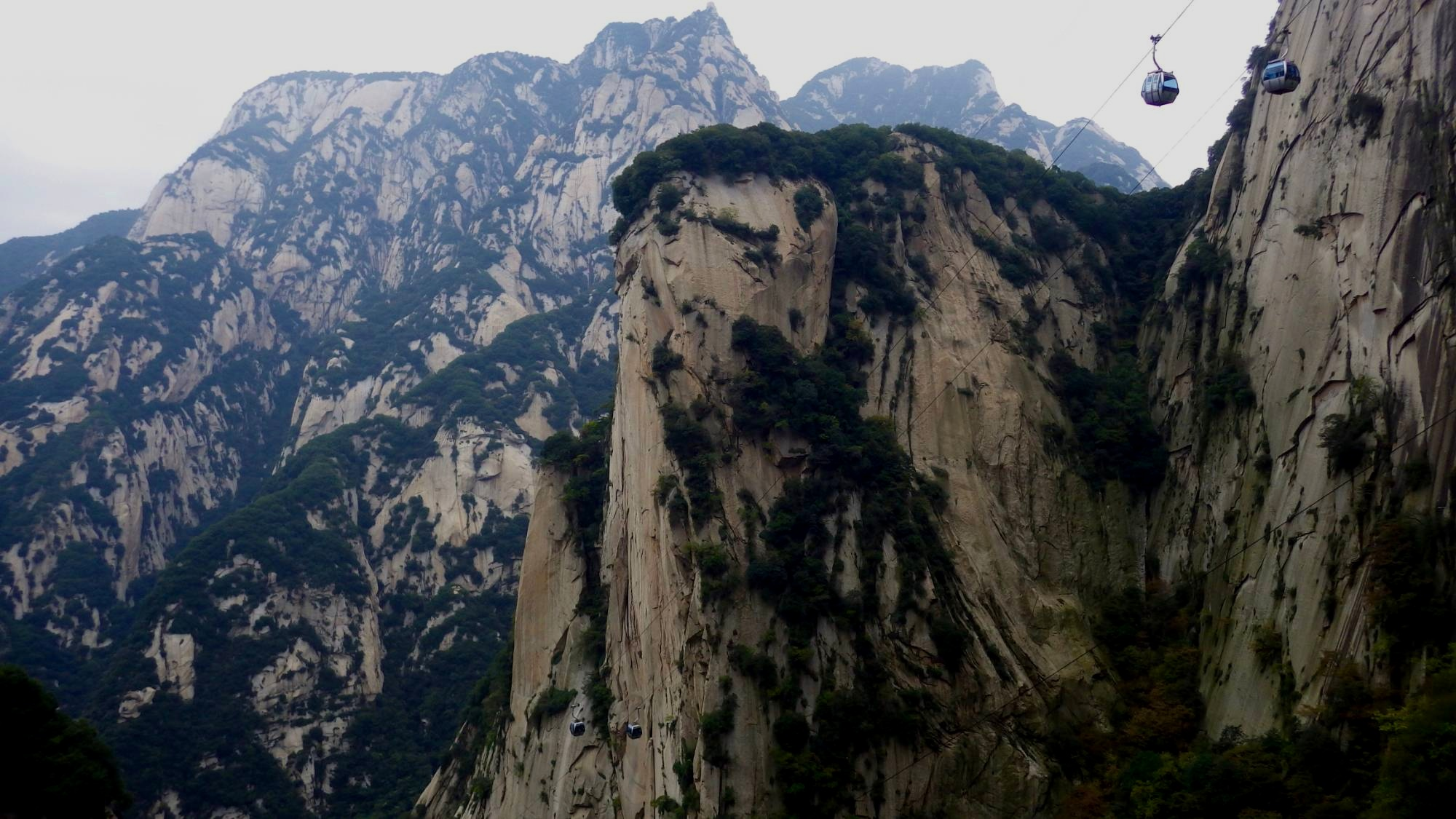 East. - Lying in the Eastern Sub Tropics. Huangshan will lure you into its home of the Immortals, The Yellow Mountains. Famed for its 'Sea of clouds' and natural hot springs, will ensure that you are distracted from the frequent rain.