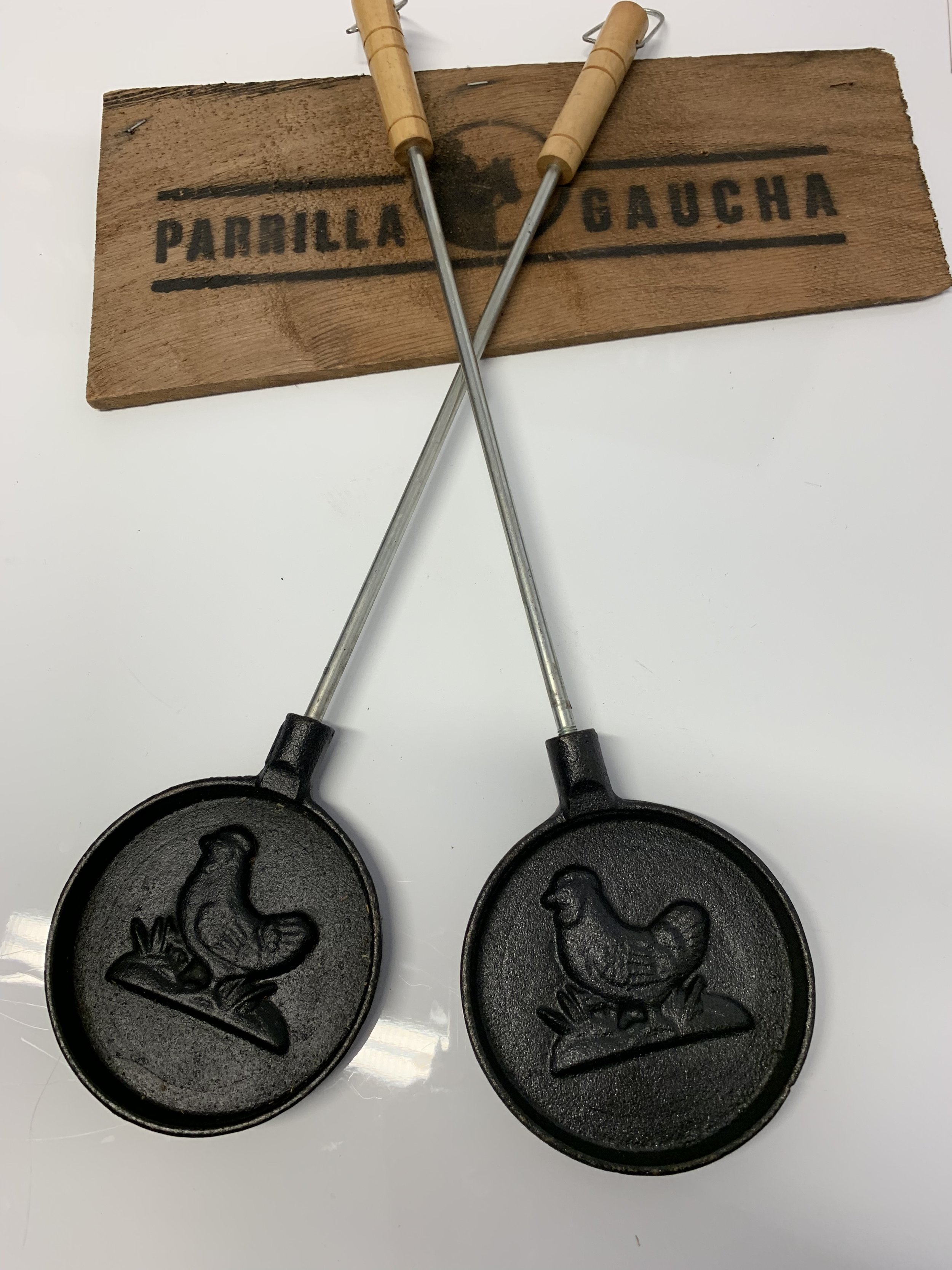 """Provoletera Long Handle£9.95 each or 2 for £12.95 - """"Provoleta"""" is usually served at the beginning of a meal. Chunks of Italian provolone, a drop of olive oil and oregano and the end result is a golden brown shell sheltering gooey cheese goodnesss, the perfect companion for your """"Parrillada"""" or selection of meat on the grill. You can use it on virtually any surface, too, from stove tops and grills to campfires"""