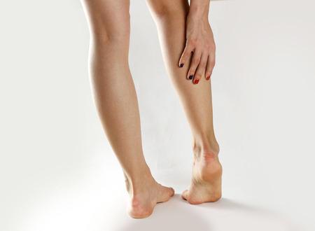 88767426_S_woman_leg_cramp_heel_pain_Achilles_tendonitis_injury.jpg