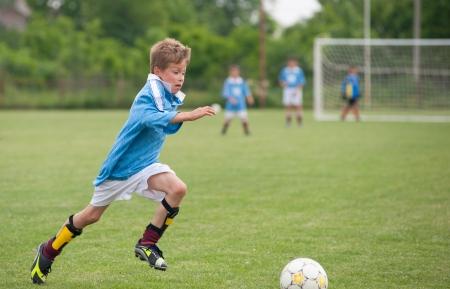 9647147_S_Kid_Soccer_Sport_Soccer Ball_Soccer Field.jpg