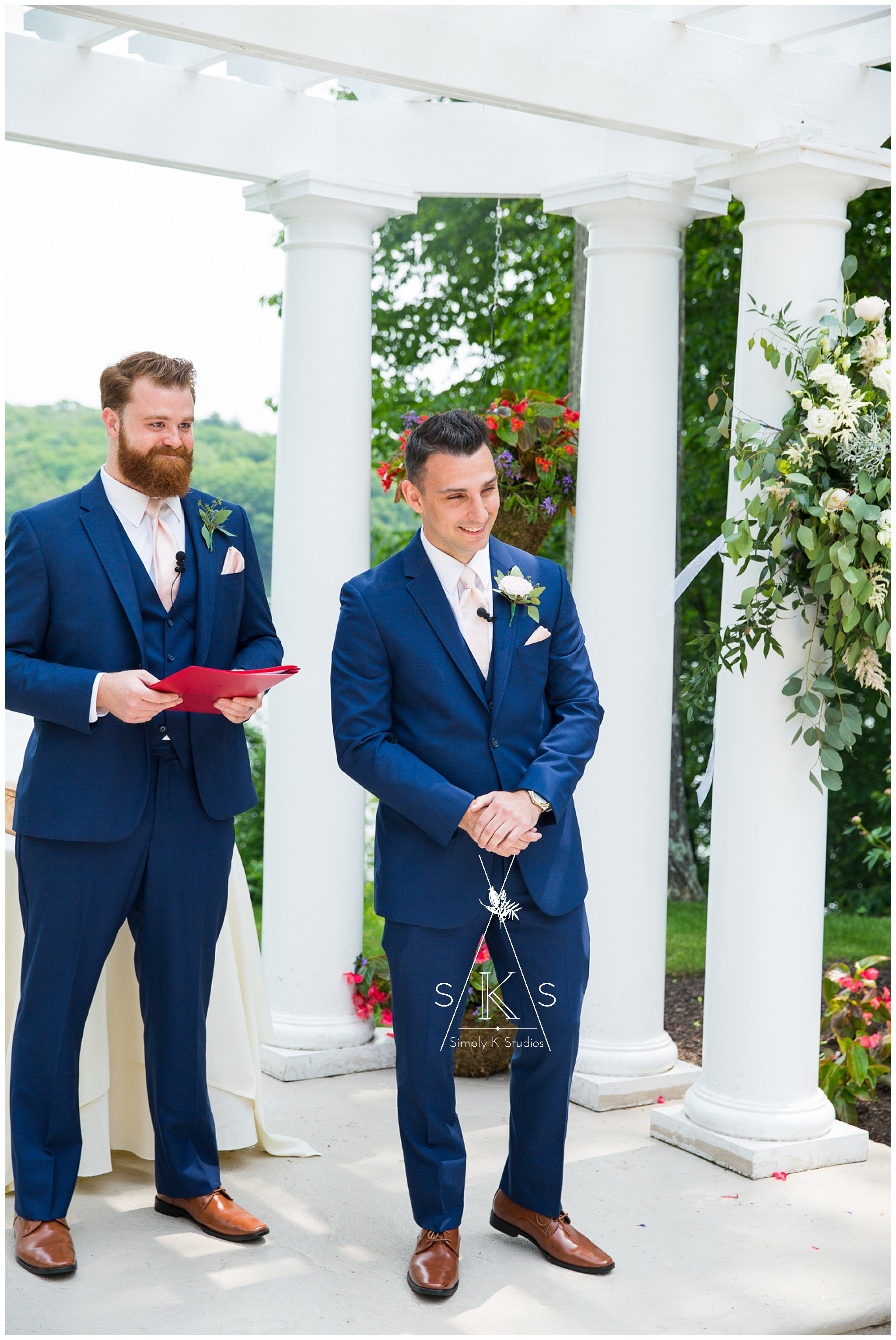 37 Grooms First Look.jpg