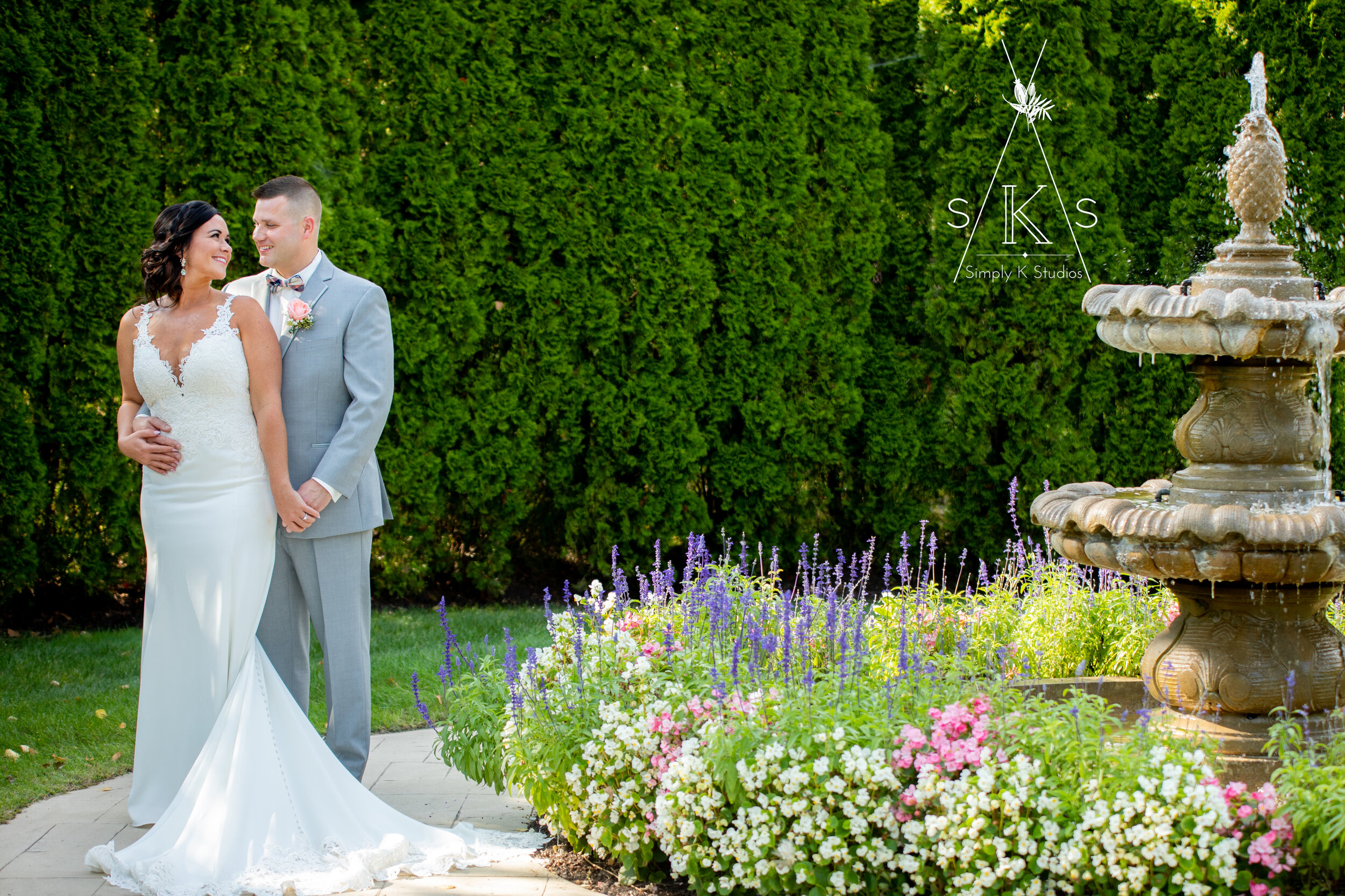 bride and groom by fountain