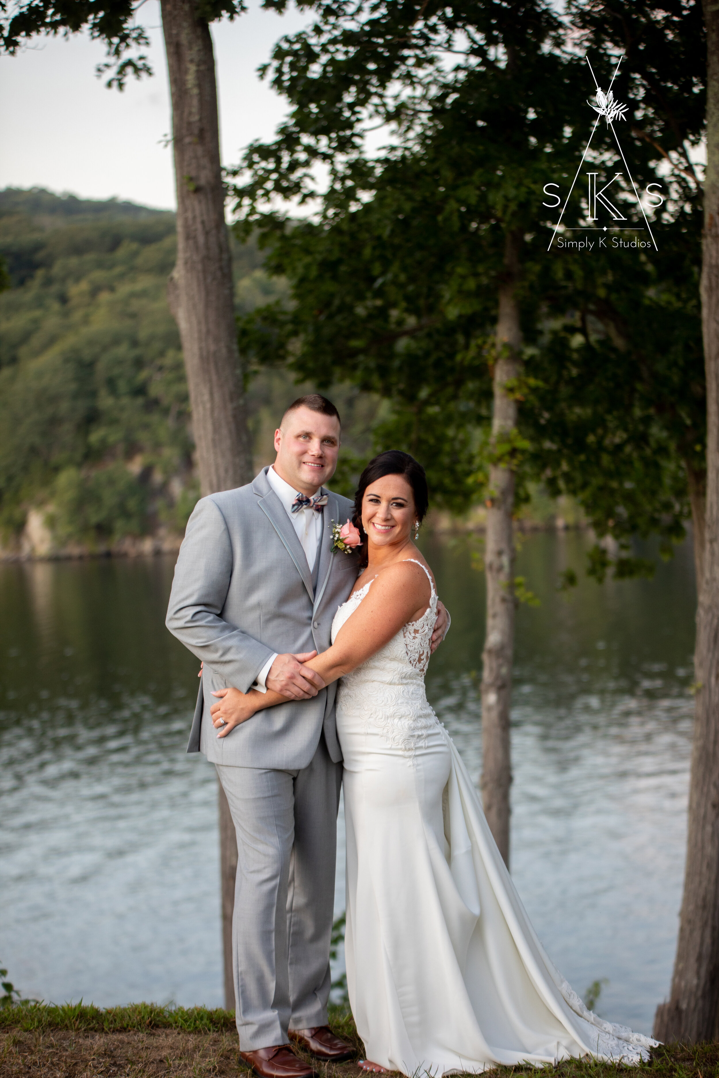 couple in front of water