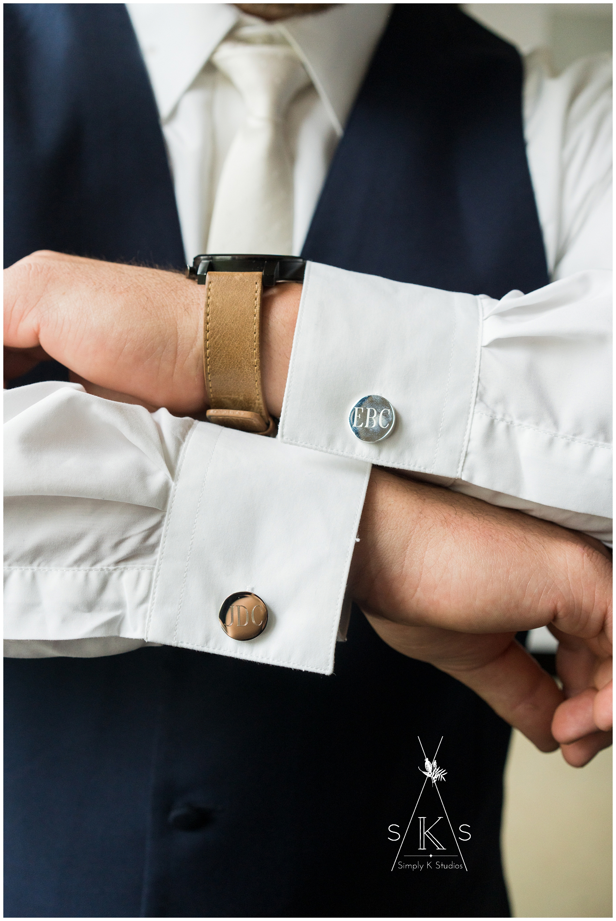 Groom with custom cufflinks for his wedding