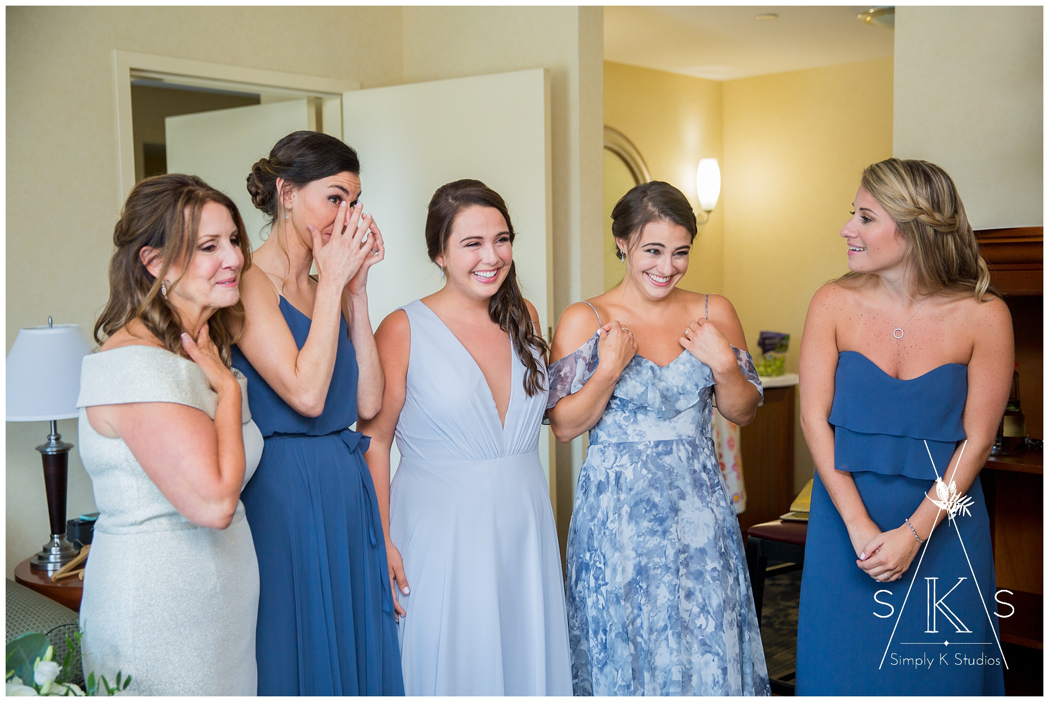 Bridesmaids with emotion at seeing the bride