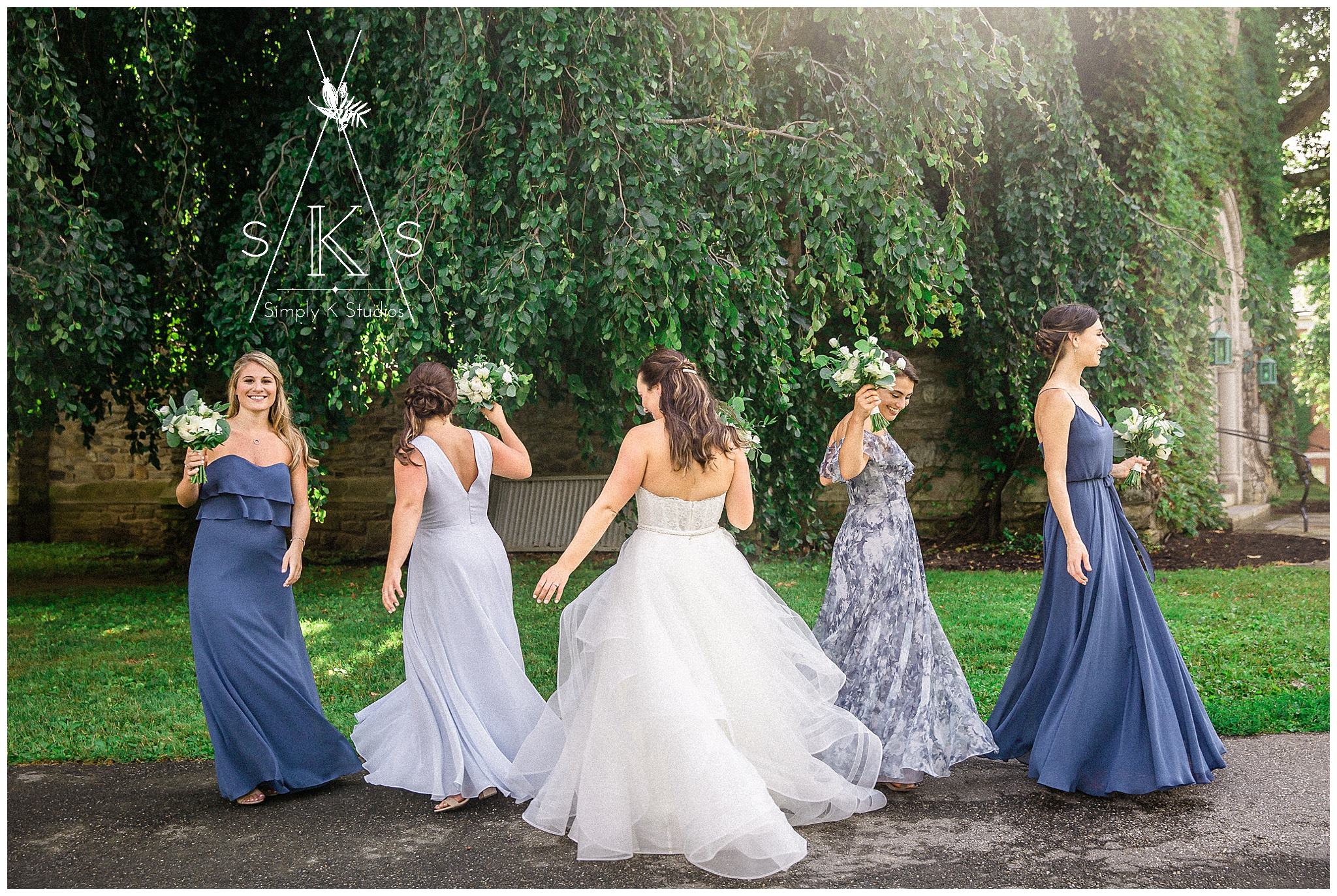 Bridesmaids twirling in their dresses