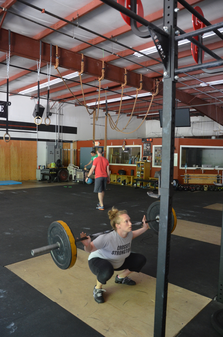 Renee getting deep into her back squat.