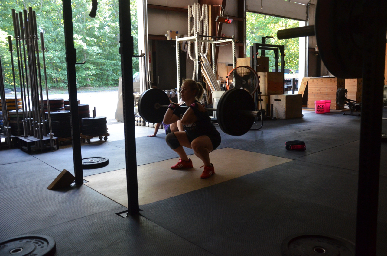 Courtney showing solid depth at the bottom of her squats.