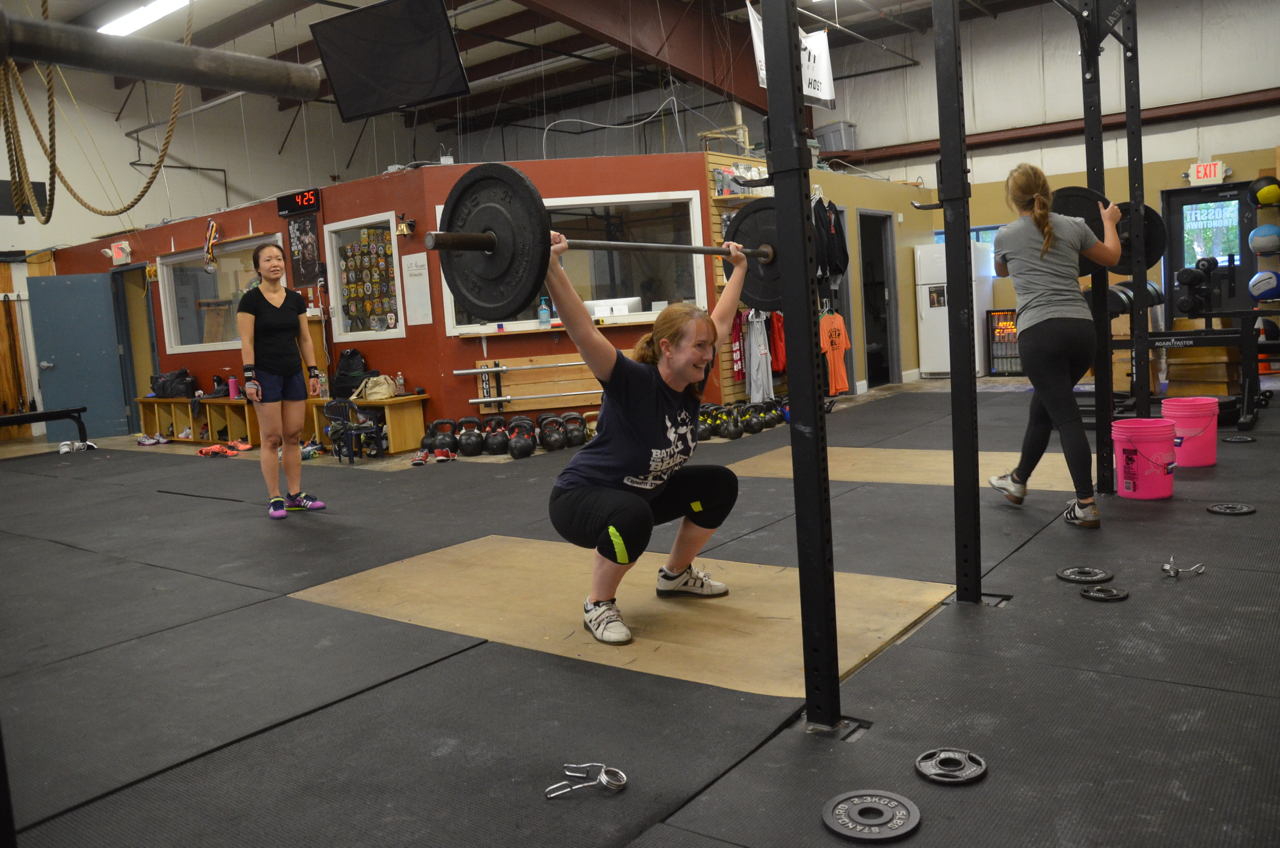 Becky loves overhead squats.
