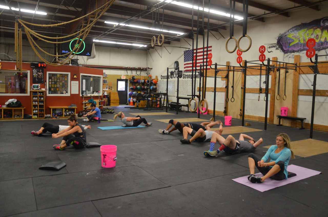 The 9:30 class working through probably my personal least favorite workout...100 sit-ups for time.
