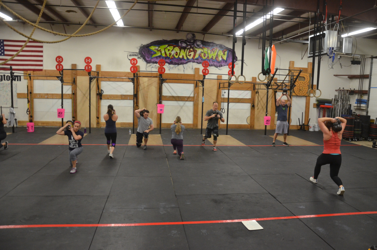 The 4pm class working through their kettlebell lunges.