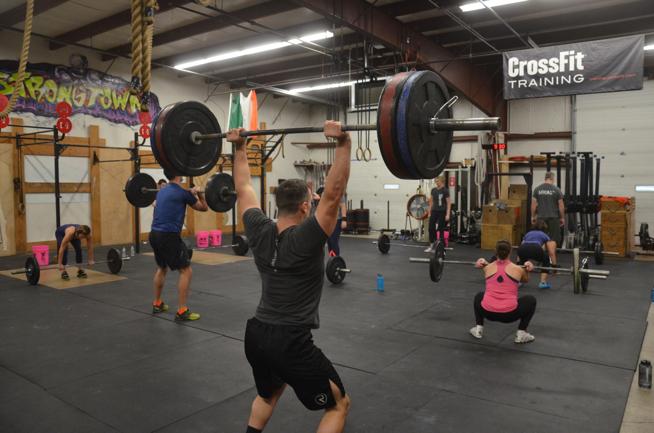 Kevan showing a solid push jerk to get the weight overhead.
