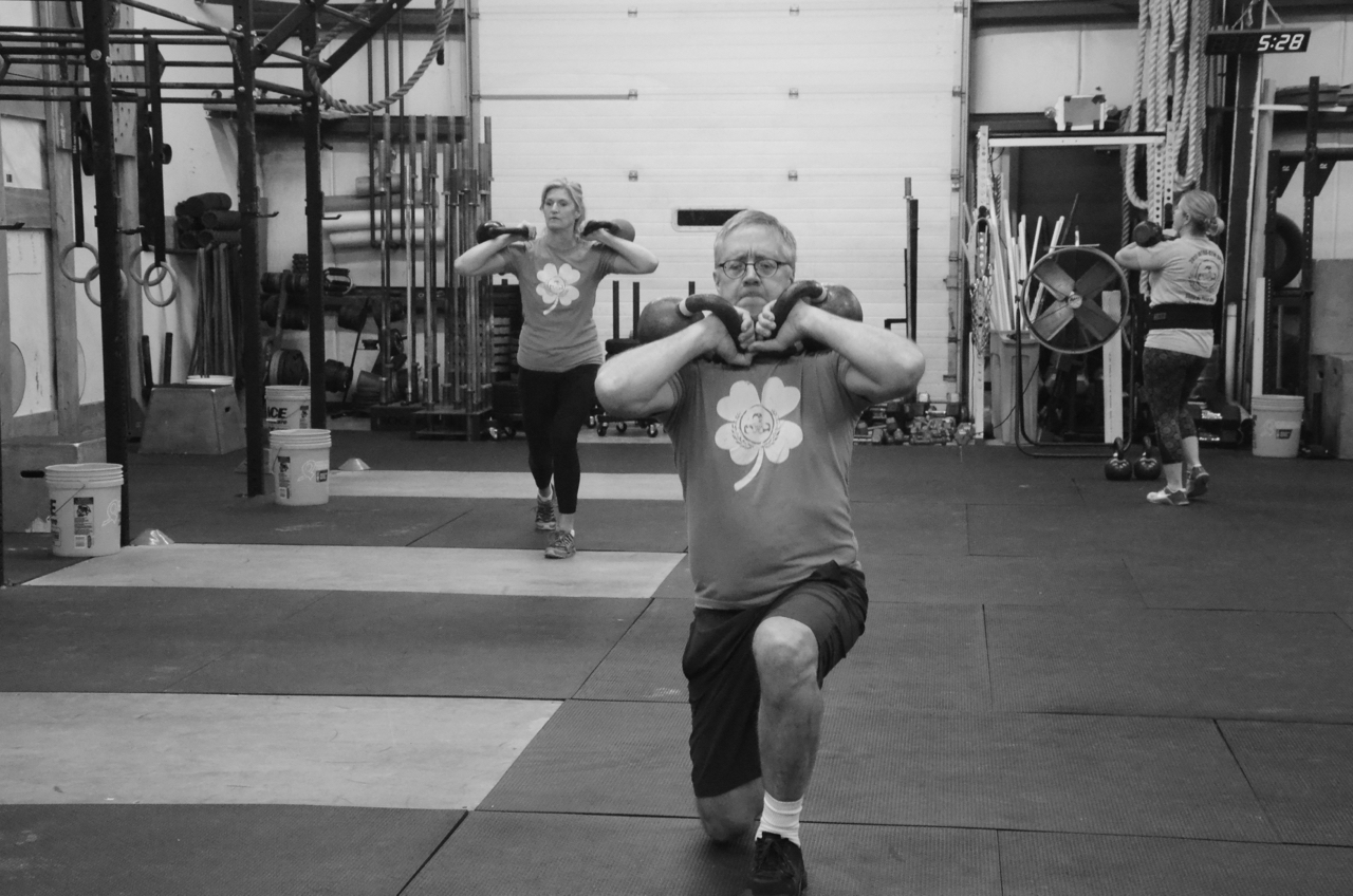 Dave looking solid during his double kettlebell lunges.