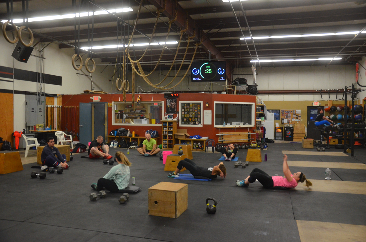 The 4pm class working through their minute of sit-ups.