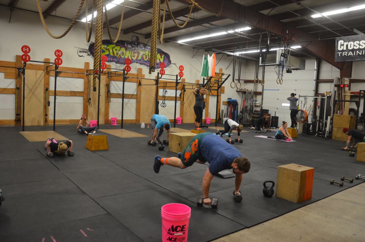 War and 9:30 class during their dumbbell burpee deadlifts.