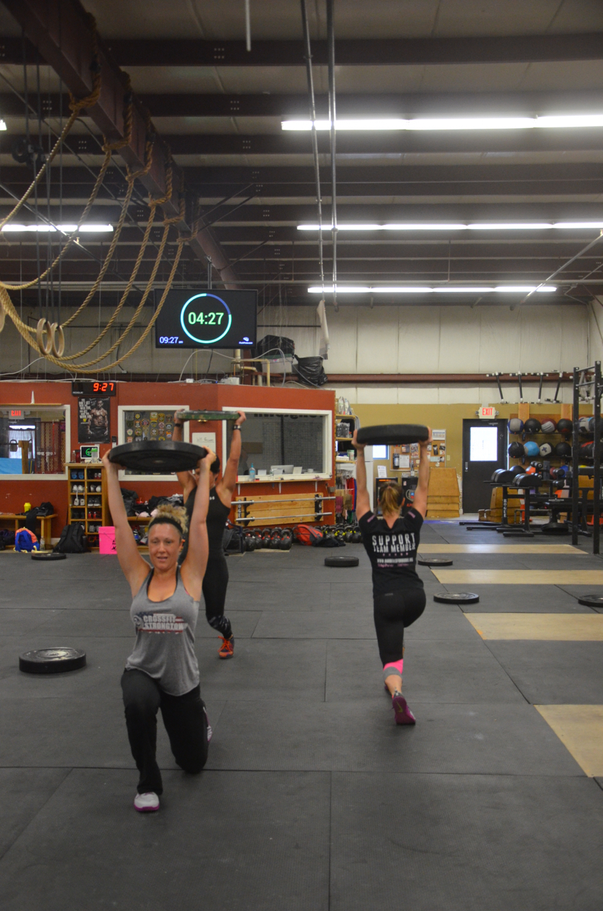 Saturday's 9am ladies all showing great lockouts on their overhead walking lunges.