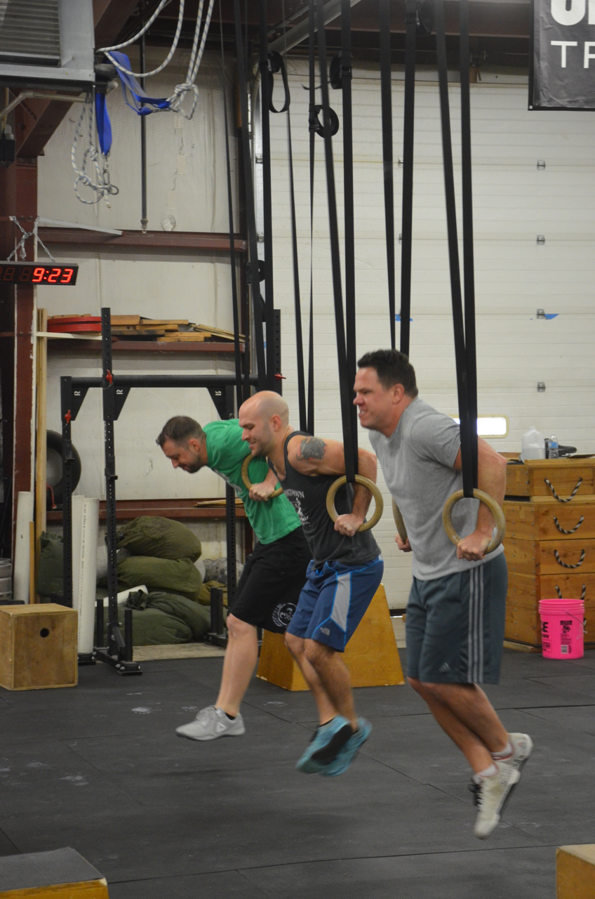Seth, Timmy, and Dan starting their 21 ring dips.