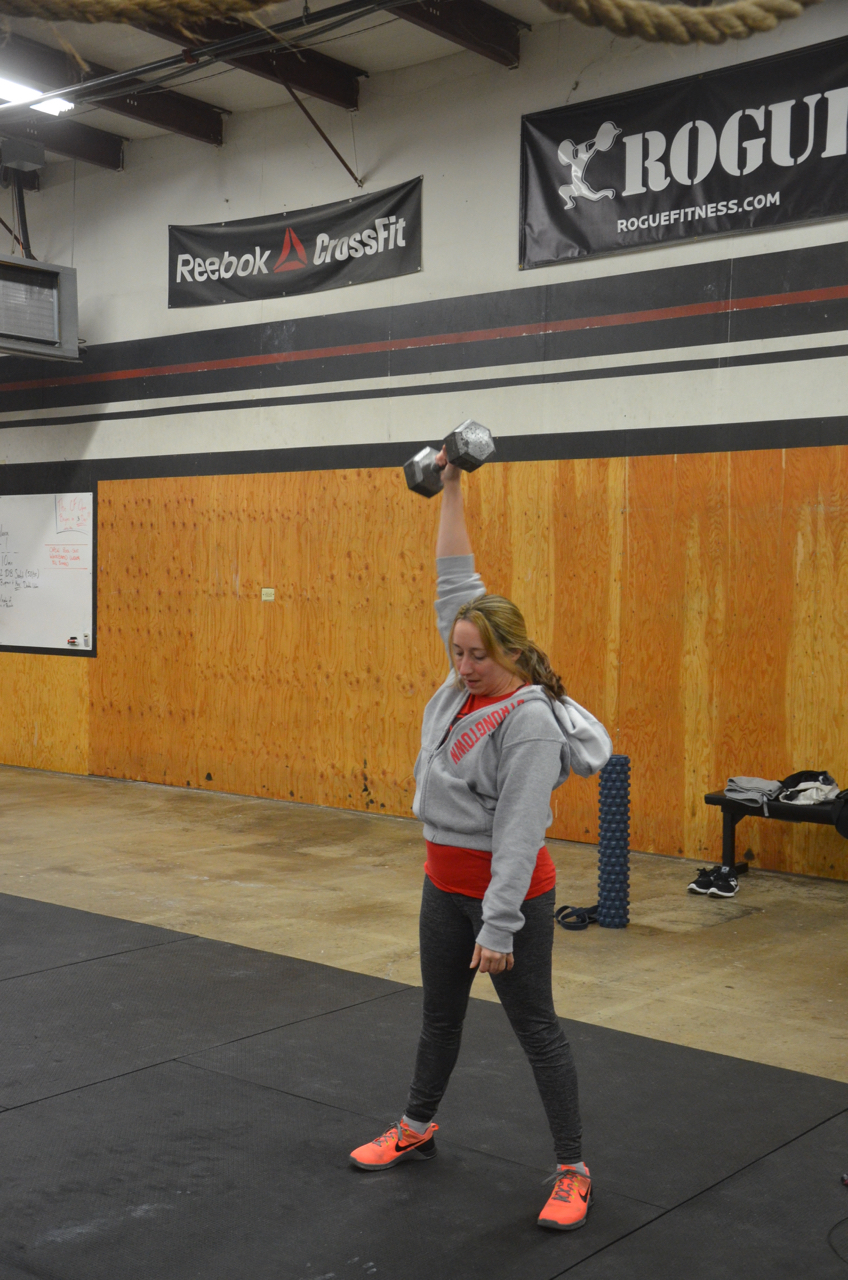 Annette looking strong on her dumbbell snatch.