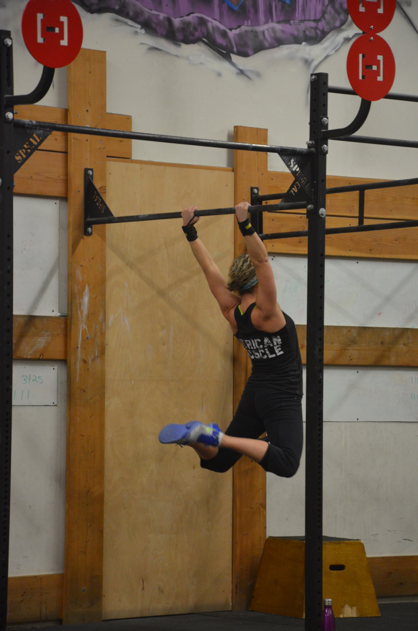 MaryBeth showing a strong kip on her pull-ups