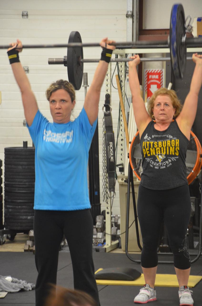 MaryBeth & Bonnie working through their hang clean & jerks.