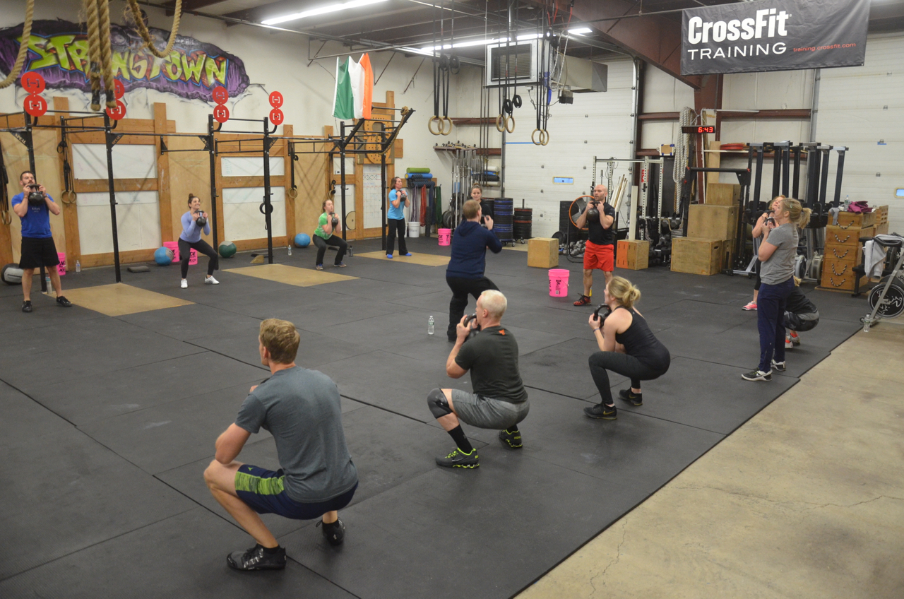 The 6pm class working through their goblet squats.