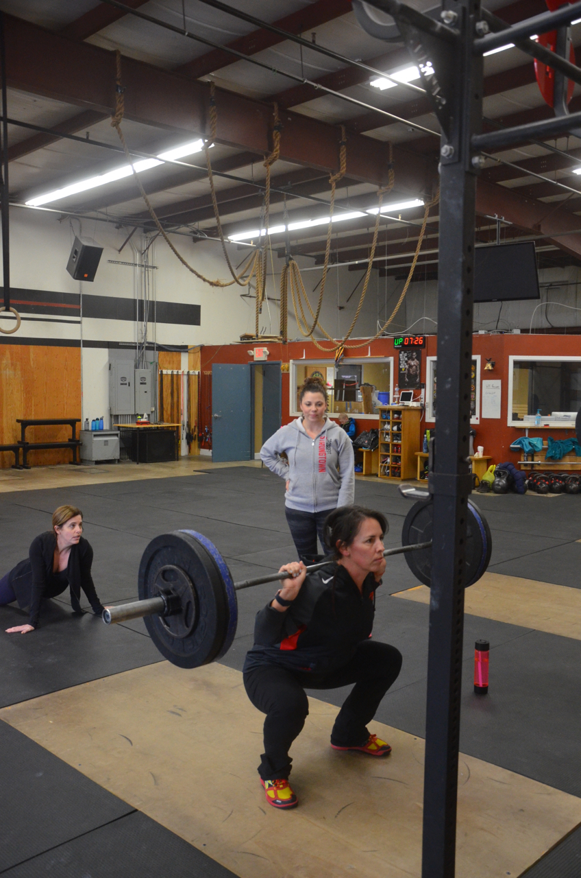 Kristin squatting, Tiff approving, and Suzie has 3 arms?