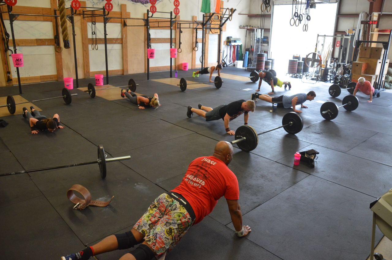 The 9:30 class working through their minute of hand release push-ups.