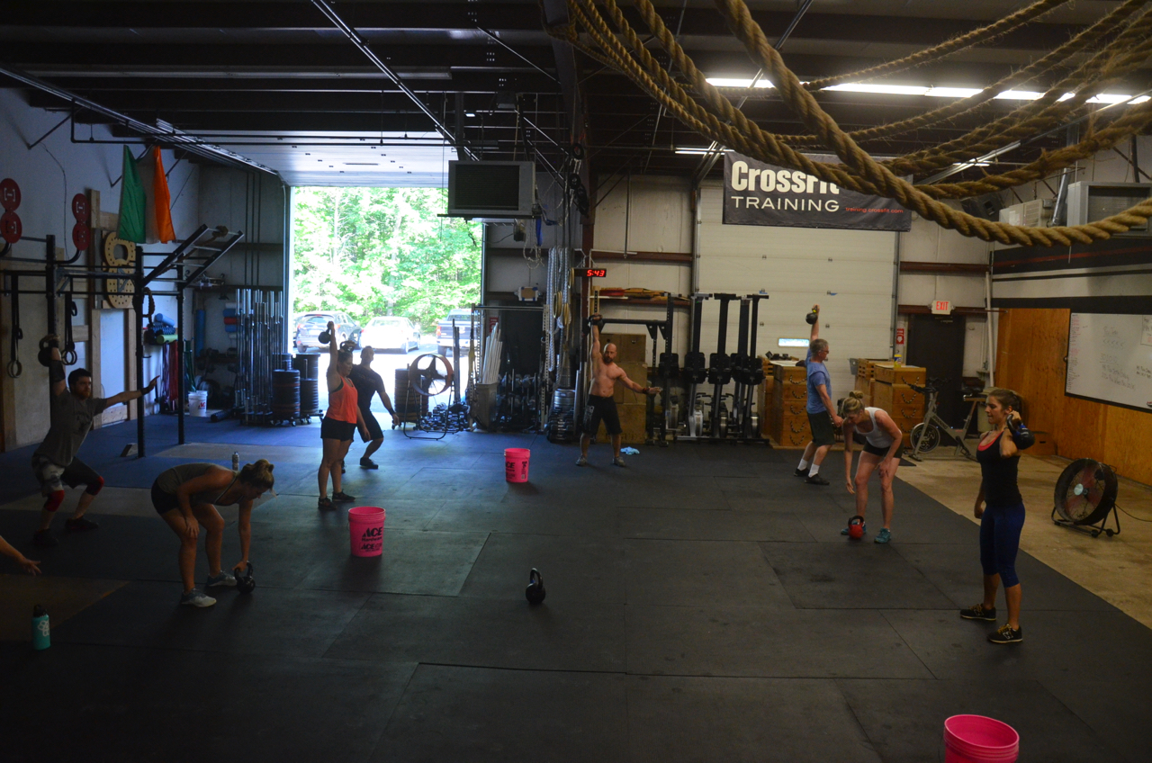 The 5pm class during their kettlebell push jerks.
