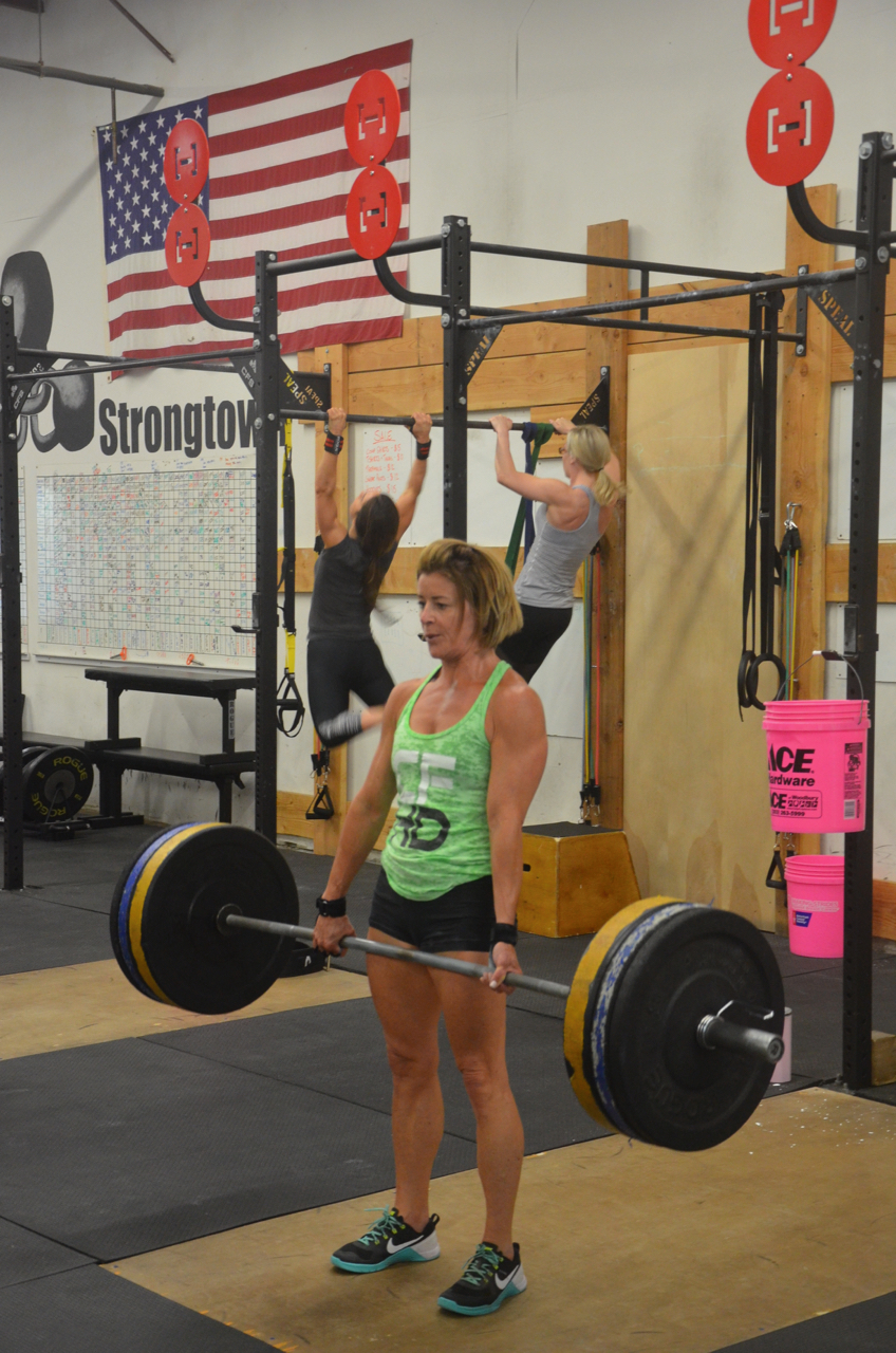 Ang showing a great lockout at the top of her deadlifts.