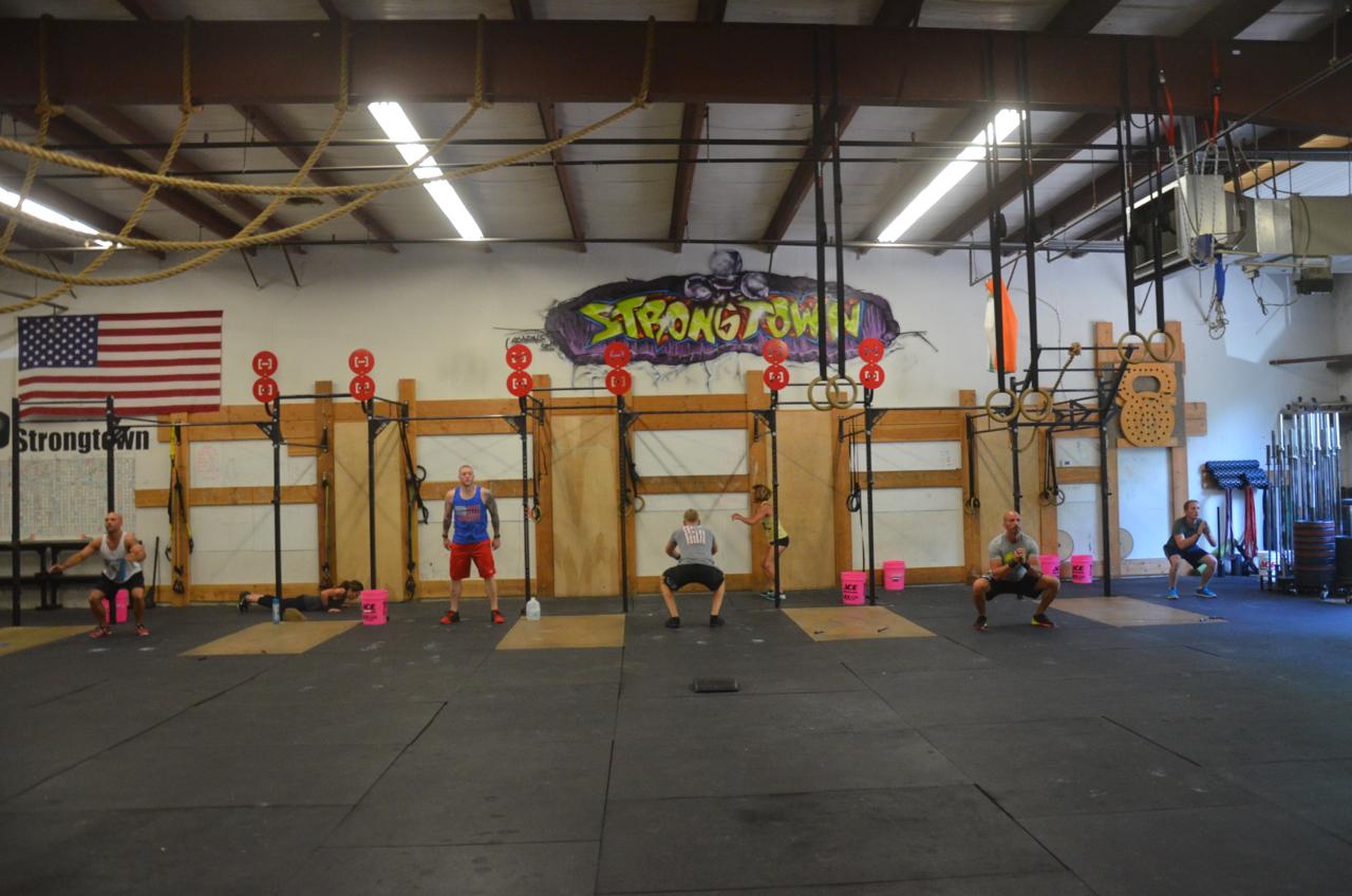 The 4pm class moving through their air squats.